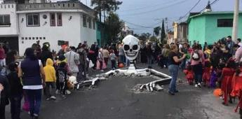 Calaveras rompen pavimento en Tláhuac por Día de Muertos