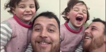 Padre transforma el miedo a risas: Juega con su hija y el estallido de las bombas en Siria