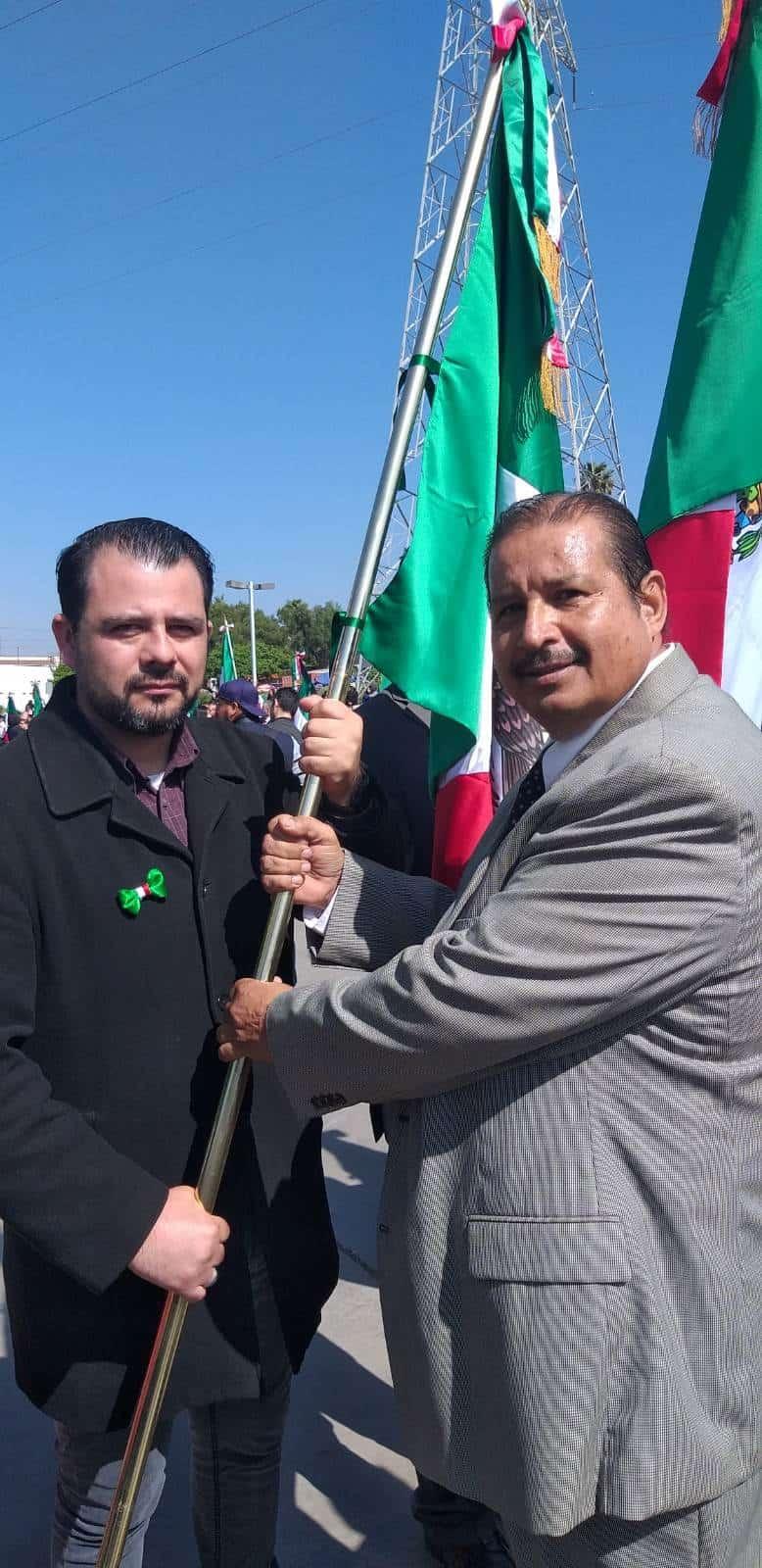 Desfile conmemorativo y e histórica incineración de bandera