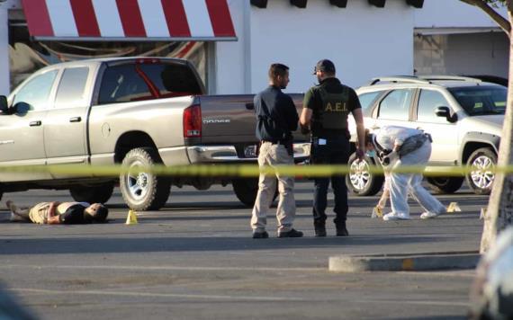 Asesinan a joven dentro de estacionamiento de Macroplaza