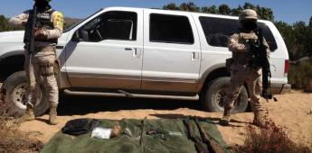 Aseguran camioneta con drogas y armas