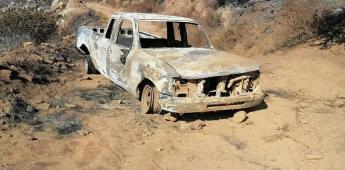 Localizan vehículo con restos humanos en su interior