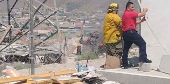 Se registra incendio de una casa de material reciclado en un predio invadido