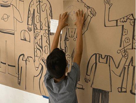 La caricatura toma las calles de Ciudad de Juárez para visibilizar la problemática migrante.